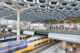 Treinen passeren op station Den Haag Centraal, foto: ProRail/Rob van Esch