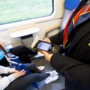 OV-chipcontrole in de trein door een NS-conducteur, foto: ANP