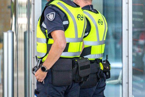 Beveiligers, boa's op Utrecht Centraal, foto: ANP