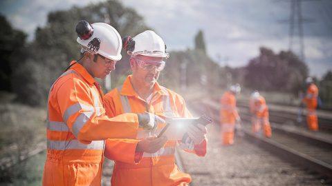 Railway workers using tablet computer