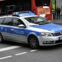 Een politieauto in het centrum van Aken in Duitsland, foto: ANP
