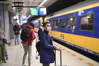 Reizigers op station Schiphol, foto: ANP